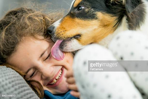 Little Girl Laughing at Her Dog