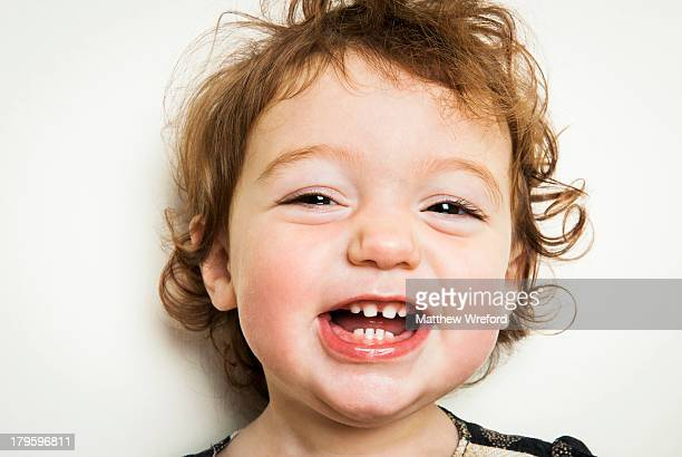 Little girl laughing with gappy teeth.