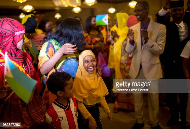 A little girl laughs as she dances with her family to the music of singer Dahir Youssouf during Djibouti's 41st Independence Day celebration at the...
