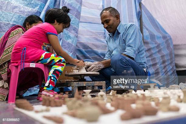 Little Girl Learning Pottery Turning, Singapore