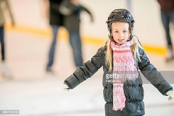 Little Girl Learning to Ice Skate