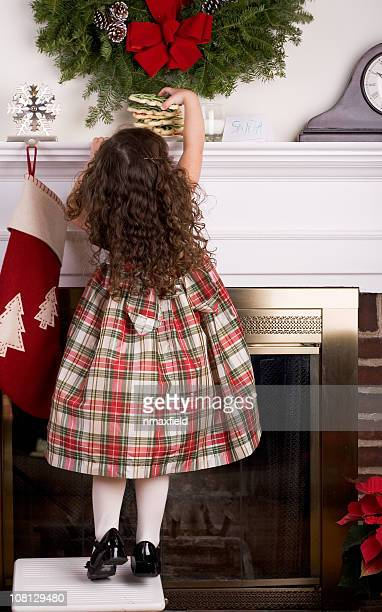 little girl leaving cookies for santa - extra long stock pictures, royalty-free photos & images