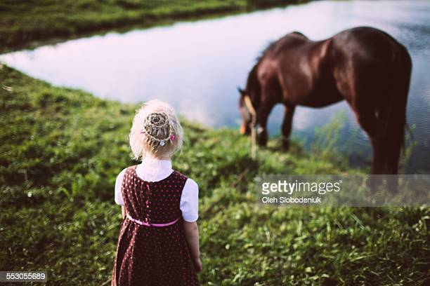 little girl look at horse - girl blowing horse stock pictures, royalty-free photos & images