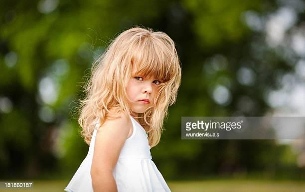 Little girl looking a bit grumpy