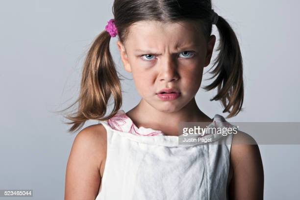 Little girl looking angry