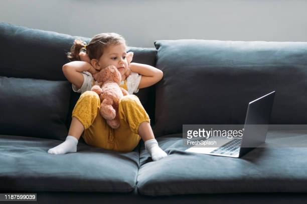 little girl looking at laptop - preschool student stock pictures, royalty-free photos & images