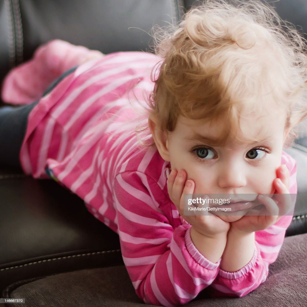 Little Girl Using A Mobile Phone High-Res Stock Photo