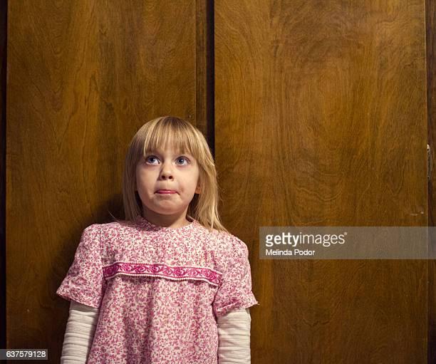 little girl looking awkward