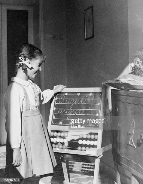 Little Girl Looking Blackboard in 1955.Black And White