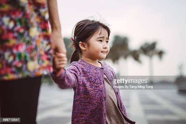 Little girl looking far away in thought