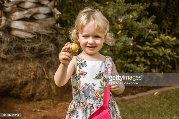 little girl looking for easter eggs - easter sunday stock pictures, royalty-free photos & images