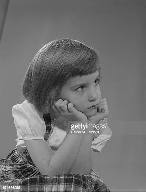 little girl looking serious - depression sadness stock pictures, royalty-free photos & images