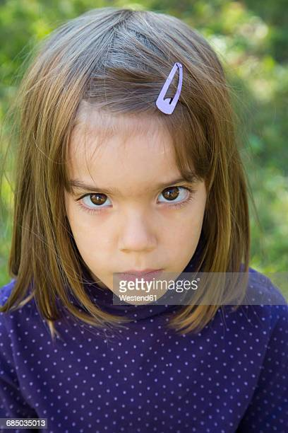 Little girl looking serious, portrait