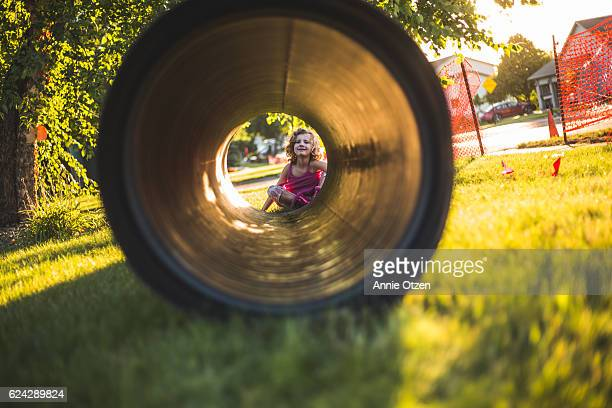 Little Girl looking through a Tube