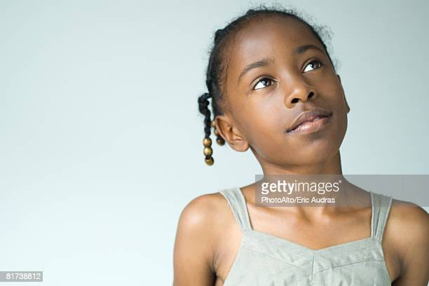 little girl looking up, head and shoulders, portrait - one girl only stock pictures, royalty-free photos & images