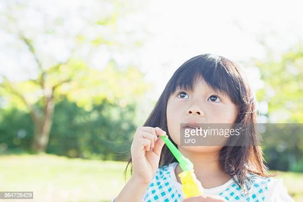 Little girl looks at the sky