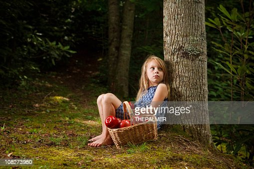 Little Girl Lost In The Forest Stock Photo | Getty Images