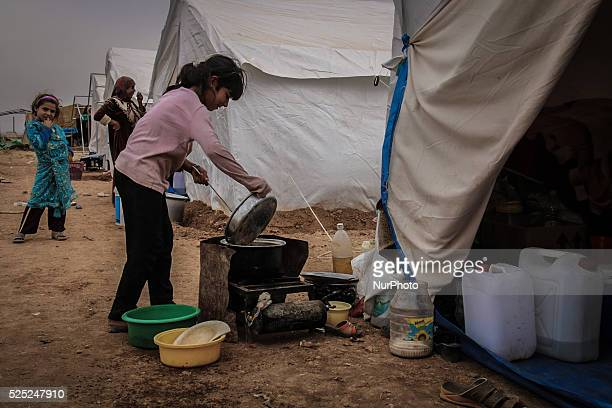 Little girl made food in a camp on the southern outskirts of the northern Syrian city of Aleppo on October 22, 2015. Tens of thousands of Syrians...
