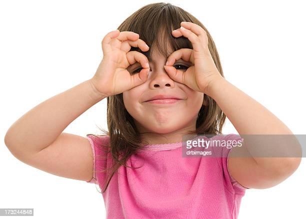 Little Girl Makes Finger Eyeglasses