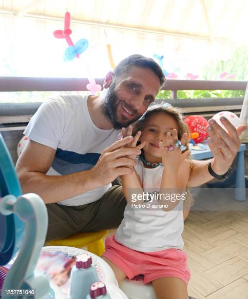 little girl makes up her dad - enamel stock pictures, royalty-free photos & images