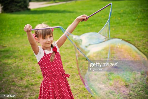 LIttle girl making big bubbles