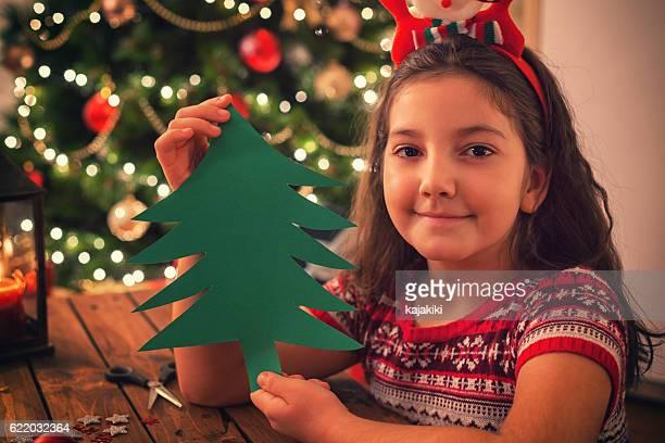 Little Girl Making Decoration for Christmas