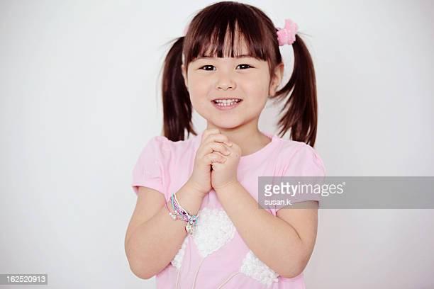 Little girl making gongxi hand signs