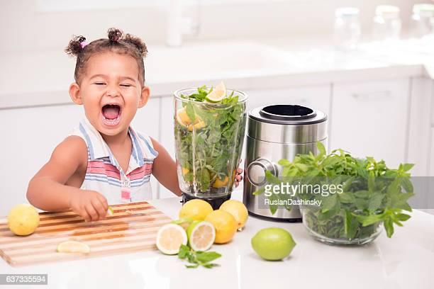 Little girl making lemonade.