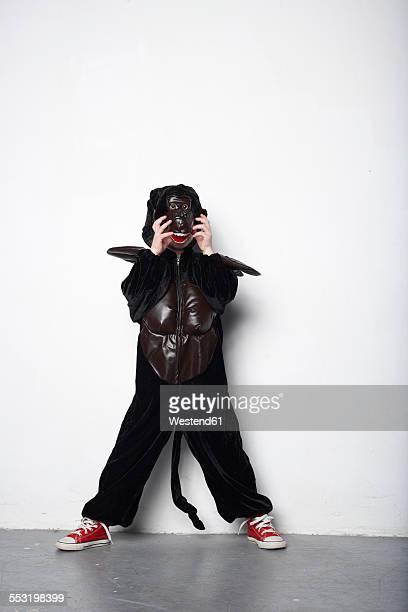 Little girl masquerade as a gorilla