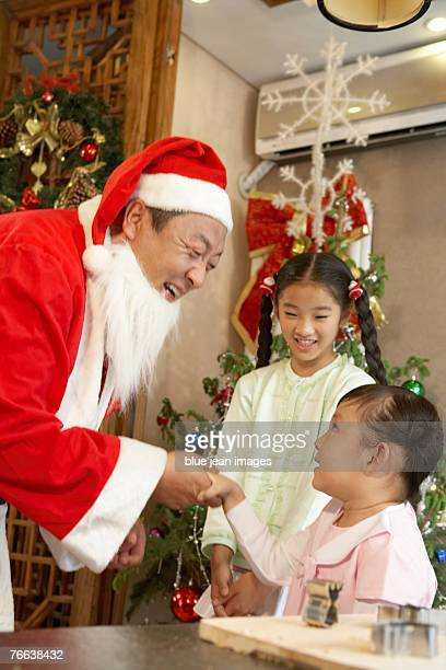 A little girl meets Santa Claus.