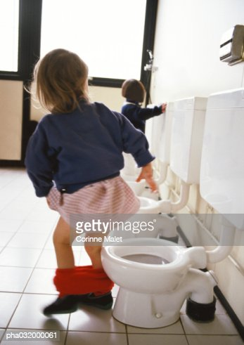 Little Girl Next To Childrens Toilet With Red Panties