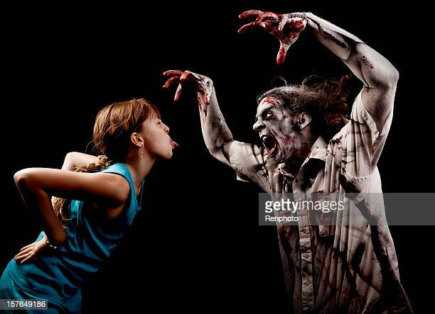 little girl not afraid of monsters - zombie girl stock photos and pictures