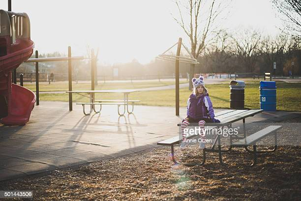 Little Girl on a Picnic Bench