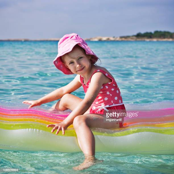 little girl on a raft - hot dirty girl stock photos and pictures