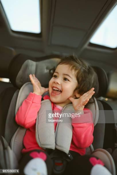 Little girl on back seat in car