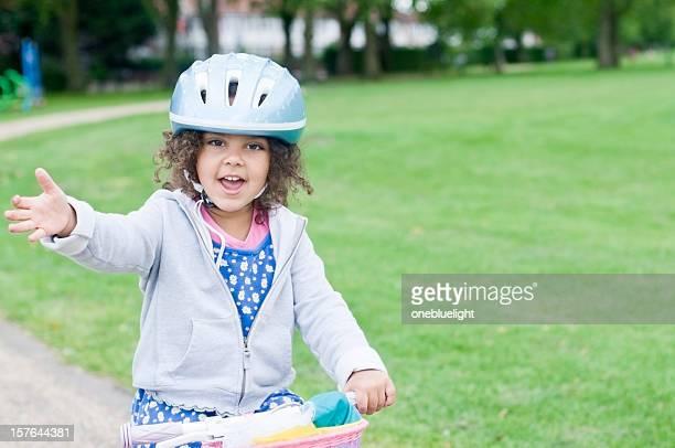 Little girl ( 4-5) on Bicycle Waving
