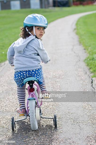 Little girl ( 4-5) on Bicycle with Helmet