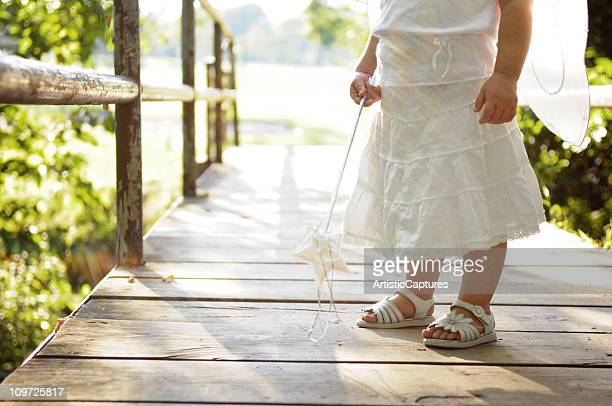 Little Girl on Bridge Wearing Fairy Wings and Holding Wand