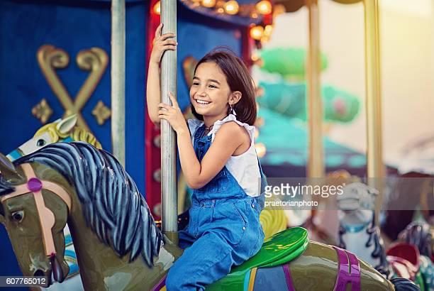 little girl on carousel - kunst cultuur en vermaak stockfoto's en -beelden