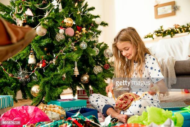 Little Girl on Christmas Morning Opening Presents
