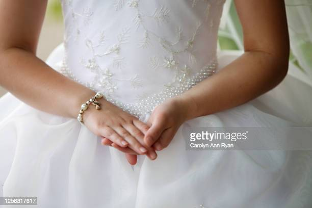 little girl on communion day - communion stock pictures, royalty-free photos & images