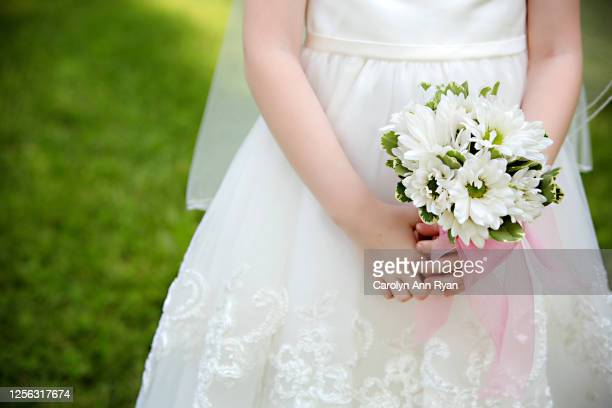 little girl on communion day - bridesmaid stock pictures, royalty-free photos & images