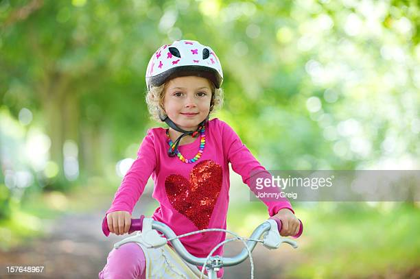 Little girl on her bicycle