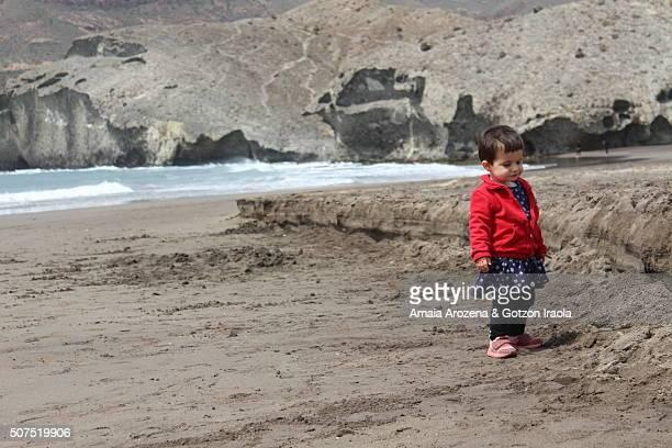 Little girl on Monsul beach, Cabo de Gata Natural Park