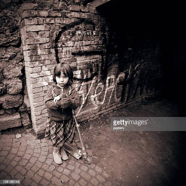 Little Girl on Scooter in Urban Setting