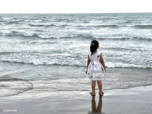 little girl on the beach - iran stock pictures, royalty-free photos & images
