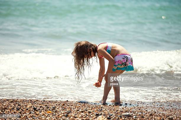 little girl on the beach - butlins stock pictures, royalty-free photos & images