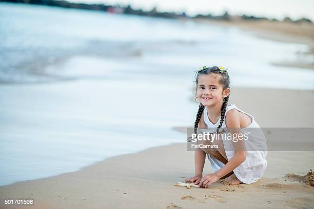 Little Girl on the Beach with a Starfish