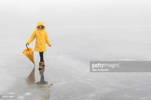 Little girl on the frozen lake