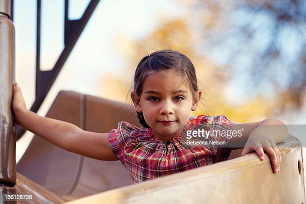 little girl on twisting slide at park - rebecca nelson stock pictures, royalty-free photos & images